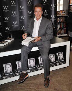 Schwarzenegger signing his 'Total Recall'. Photo: Nils Jorgensen/Rex Features.
